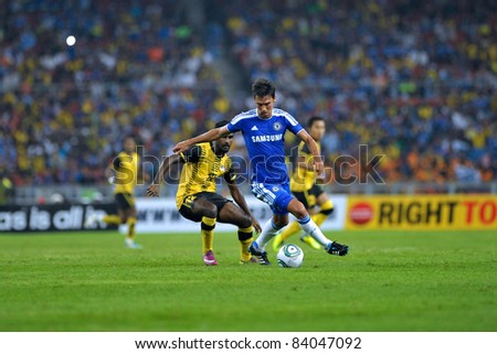 KUALA LUMPUR, July 21 : Chelsea's Paulo Ferreira (blue) and Malaysian Gary Stevan (12) in action during a preseason match agains Malaysia on July 21, 2011 in Kuala Lumpur, Malaysia. Chelsea won 1-0