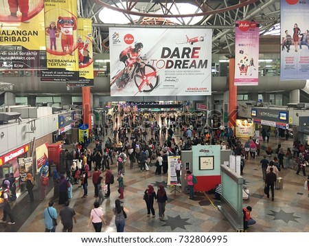 KUALA LUMPUR - JULY 10, 2017: Commuters in KL Sentral transportation hub in Brickfields, KL. KL Sentral is Malaysia largest intermodal transportation hub.