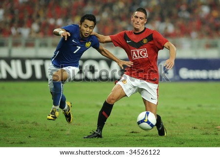 KUALA LUMPUR- JULY 20: Federico Micheda (R) of Manchester United team and Malaysian Aidil Zafuan (L) in action during friendly match (2nd Match) against Malaysia, July 20, 2009 in Kuala Lumpur.