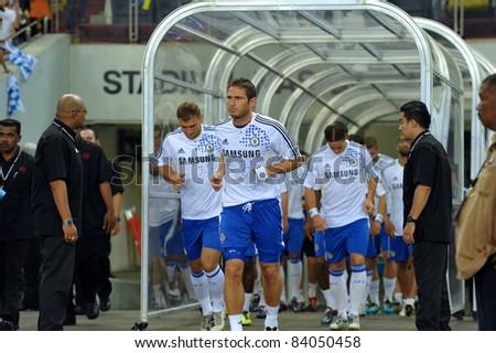 KUALA LUMPUR, JULY 21 : Frank Lampard and Chelsea player walked into the stadium during a preseason match against Malaysia on July 21, 2011 in Kuala Lumpur, Malaysia. Chelsea won 1-0 - stock photo