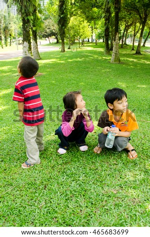 Kuala Lumpur - july 21 2016 : kids playing at KLCC garden in the summer.
