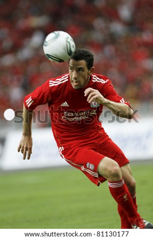 KUALA LUMPUR - JULY 16 : Liverpool football club player Maxi Rodriguez controls a ball during a friendly match against Malaysia XI on July 16, 2011 in Kuala Lumpur, Malaysia. Liverpool won 6-3. - stock photo