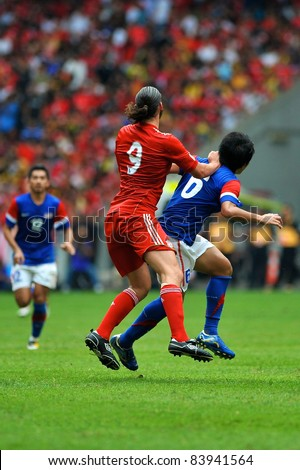 KUALA LUMPUR - JULY 16: Liverpool player Andy Carroll and Malaysian Muhamad Fadhli during a friendly match against Malaysia on July 16, 2011 in Kuala Lumpur, Malaysia. Liverpool won 6-3.