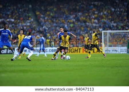 KUALA LUMPUR, July 21 : Malaysian Thamil Arasu (center yellow-14) in action during a preseason match agains Malaysia on July 21, 2011 in Kuala Lumpur, Malaysia. Chelsea won 1-0 - stock photo