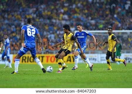 KUALA LUMPUR, July 21 : Malaysian Thamil Arasu (center yellow) in action during a preseason match agains Malaysia on July 21, 2011 in Kuala Lumpur, Malaysia. Chelsea won 1-0 - stock photo