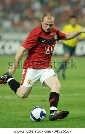 KUALA LUMPUR- JULY 20: Wayne Rooney of Manchester United in action during friendly match (2nd Match) against Malaysia at National Stadium, July 20, 2009 in Kuala Lumpur. - stock photo