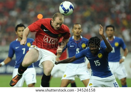 KUALA LUMPUR - JULY 20: Wayne Rooney of Manchester United team in action during friendly match (2nd Match) against Malaysia at National Stadium, July 20, 2009 in Kuala Lumpur.  Manchester won 2-0. - stock photo