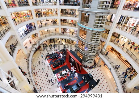 KUALA LUMPUR - JUN 21: View of the interior of Suria KLCC shopping mall on Jun 21, 2015 in Kuala Lumpur, Malaysia. Opened in 1998 Suria KLCC houses 400 stores covering 1,500,000 sq m of retail space. - stock photo