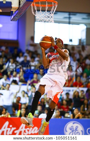 KUALA LUMPUR - JUNE 02: Tiras Wade of the Malaysia Dragons attempts a lay-up in a playoff match against San Miguel Beermen in the ASEAN Basketball League on June 02, 2012 in Kuala Lumpur, Malaysia. - stock photo