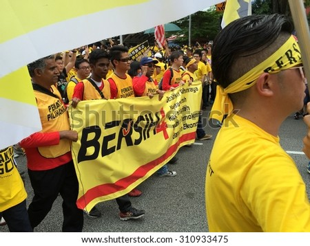 Kuala Lumpur, Malayia 29 August 2015 : Yellow shirt Supporters carry Bersih banner supporting Bersih 4 Rally for Free Fair Elections. Bersih organized Rallies 29/30 August in cities around Malaysia