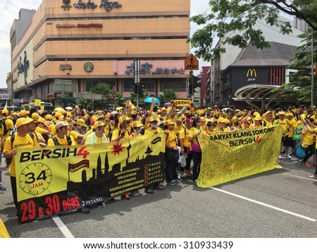 Kuala Lumpur, Malayia 29 August 2015 : Yellow shirt Supporters display banner and signature campaign Bersih Rally for Free Fair Elections. Bersih organized Rallies 29/30 Aug in cities around Malaysia  - stock photo