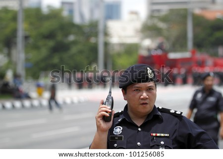 KUALA LUMPUR, MALAYSIA - APRIL 28: A police inspector at the protest rally organized by the coalition for clean and fair election on April 28, 2012 in Dataran Merdeka, Kuala Lumpur, Malaysia.