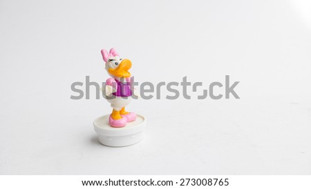 Kuala Lumpur, Malaysia - April 25, 2015: A studio shot of Daisy Duck toy figure, a cartoon character created in 1940 by Walt Disney Productions as the girlfriend of Donald Duck.  - stock photo