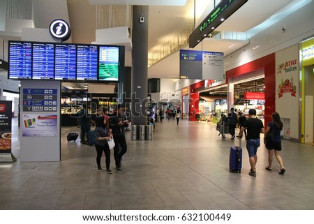 KUALA LUMPUR, MALAYSIA - APRIL 28, 2017 : An airport-within-a-mall concept filled with retail stores in the KLIA2 building.