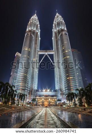 KUALA LUMPUR, MALAYSIA - APRIL 13: beatiful light show of Petronas Twin Towers and city night scene on April 13, 2013, Kuala Lumpur Malaysia. - stock photo