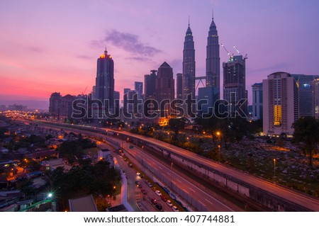 KUALA LUMPUR, MALAYSIA - APRIL 17, 2016: Cityscape view of Petronas Twin Tower at KLCC City Center during sunrise. The most popular tourist destination in Malaysian capital.