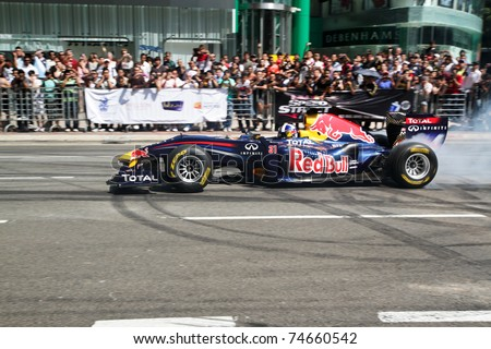 KUALA LUMPUR, MALAYSIA - APRIL 3: David Coulthard of Team RedBull in action during F1 street demonstration on April 3, 2011 in KL, Malaysia. He demonstrated the powerful F1 burnouts during the event.