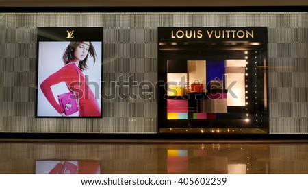 KUALA LUMPUR, MALAYSIA - April 10, 2016. Louis Vuitton shop inside Suria KLCC. Louis Vuitton is a France luxury leather goods company. Founded in Paris, France since 1854. - stock photo