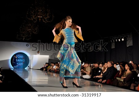 KUALA LUMPUR, MALAYSIA-APRIL 2:Model displays creation by Tom Abang Saufi during STYLO Fashion Show April 2, 2009 in Kuala Lumpur.The fashion show was held in conjunction with Malaysian F1 Grand Prix - stock photo
