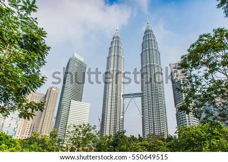 KUALA LUMPUR, MALAYSIA, APRIL 04, 2016 : Petronas Twin Towers at the morning with beautiful blue sky. Petronas Twin Towers also known as KLCC is the tallest building in Malaysia