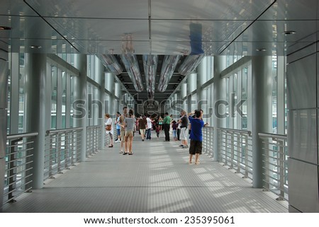Kuala Lumpur, Malaysia - April 6, 2013: Skybridge connecting Petronas Twin Towers on the 41st floor is open for visitors to experience scenery of Kuala Lumpur from the world's tallest twin towers.  - stock photo