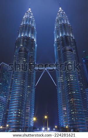 KUALA-LUMPUR, MALAYSIA - APRIL 07: Twin towers Petronas at night April 07, 2011, Kuala Lumpur, Malaysia. - stock photo