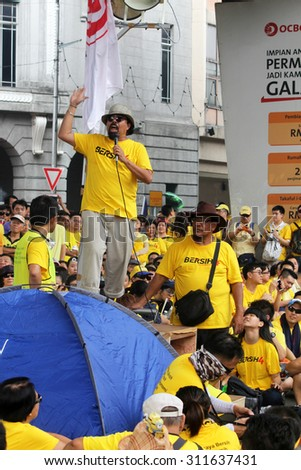 KUALA LUMPUR, MALAYSIA - AUGUST 30, 2015 : A Bersih protest leader giving a speech to protestors during the Bersih 4.0 rally in Kuala Lumpur. - stock photo