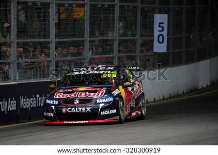 KUALA LUMPUR, MALAYSIA - AUGUST 08, 2015: Craig Lowndes from the Red Bull Racing Australia team races in the V8 Supercars Street Challenge at the 2015 Kuala Lumpur City Grand Prix. - stock photo