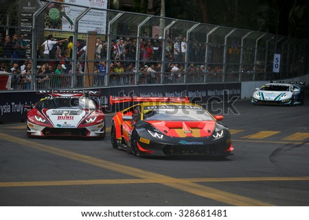 KUALA LUMPUR, MALAYSIA - AUGUST 09, 2015: Lamborghini Super Trofeo LP620 cars race in the city street circuit in the Lamborghini Blancpain Super Trofeo Race at the 2015 Kuala Lumpur City Grand Prix. - stock photo