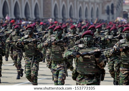 KUALA LUMPUR, MALAYSIA - AUGUST 31: Malaysian Armed Forces personnels from the Para Brigade takes part during the Independence Day celebration in Kuala Lumpur, Malaysia, 31 August 2013.  - stock photo