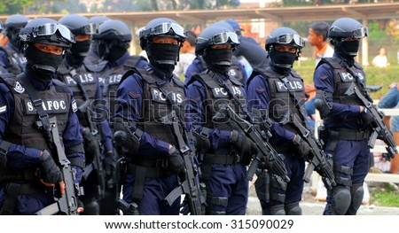 KUALA LUMPUR, MALAYSIA - AUGUST 31: Royal Malaysian Special Force participating parade celebration of Malaysia Independence day 58th in Merdeka square on August 31, 2015, Kuala Lumpur, Malaysia - stock photo