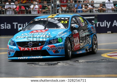 KUALA LUMPUR, MALAYSIA - AUGUST 08, 2015: Scott McLaughlin from the Volvo Polestar Racing team races in the V8 Supercars Street Challenge at the 2015 Kuala Lumpur City Grand Prix. - stock photo