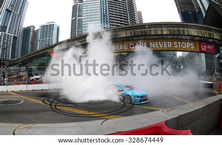 KUALA LUMPUR, MALAYSIA - AUGUST 09, 2015: Scott McLaughlin spins and burn rubber on the tracks after winning the V8 Supercars Street Challenge at the 2015 Kuala Lumpur City Grand Prix.