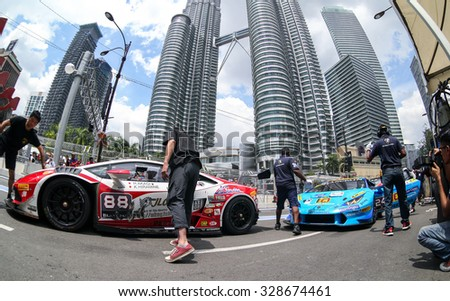 KUALA LUMPUR, MALAYSIA - AUGUST 09, 2015: The Lamborghini car of drivers H. Akagi and K. Hiramine make a pit stop in the Lamborghini Blancpain Super Trofeo Race of the 2015 KL City Grand Prix. - stock photo