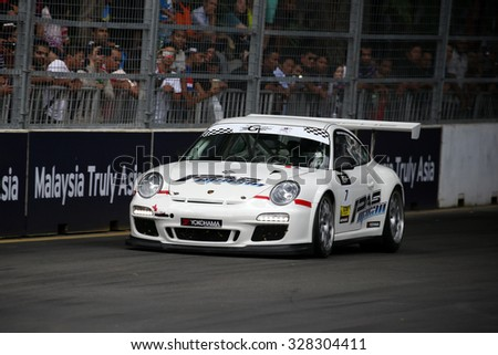 KUALA LUMPUR, MALAYSIA - AUGUST 08, 2015: Wong Kian Kuan drives a Porsche 997 Cup car takes turn 2 in the KL City GT CUP Race of the 2015 Kuala Lumpur City Grand Prix. - stock photo