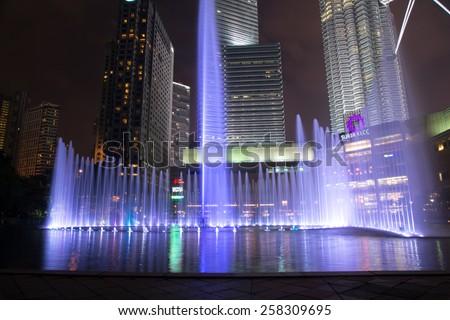 KUALA LUMPUR, MALAYSIA - CIRCA JANUARY 2015: Petronas Twin Towers at night. Petronas Twin Towers were the tallest buildings (452 m) in the world from 1998 to 2004. - stock photo