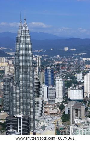 Kuala Lumpur, Malaysia - cityscape including Petronas Towers - stock photo