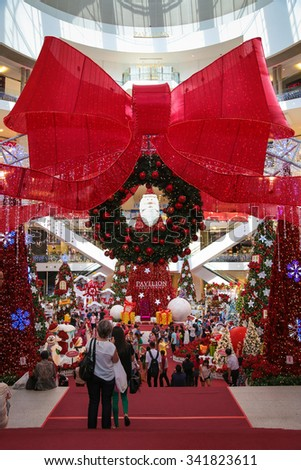 KUALA LUMPUR, MALAYSIA - 24 DEC,2014 : Families and friends come to admire the christmas decorations at Pavillion shopping complex in Kuala Lumpur, Malaysia during christmas eve. - stock photo
