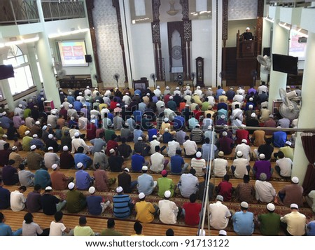 KUALA LUMPUR, MALAYSIA-DEC. 30:Muslims listen to Friday sermon deliver by the khatib (top right) in Kuala Lumpur on December 30, 2011. Male Muslims are compulsory to attend weekly Friday prayers.