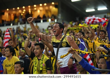 KUALA LUMPUR MALAYSIA DEC20:Unidentified fans of Malaysia during the AFF Suzuki Cup 2014 between Malaysia and Thailand at Bukit Jalil National Stadium on December 20,2014 in Kuala Lumpur,Malaysia. - stock photo