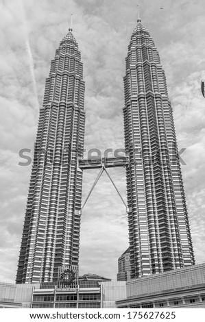 KUALA LUMPUR, MALAYSIA - DECEMBER 28: Black and white image of the Petronas Towers. Photo taken December 28, 2013 in Kuala Lumpur, Malaysia. - stock photo