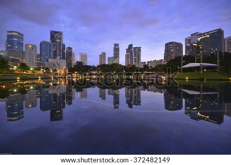 KUALA LUMPUR, MALAYSIA - DECEMBER 24 2015:Commercial buildings views from Symphony Lake at blue hour sunrise.