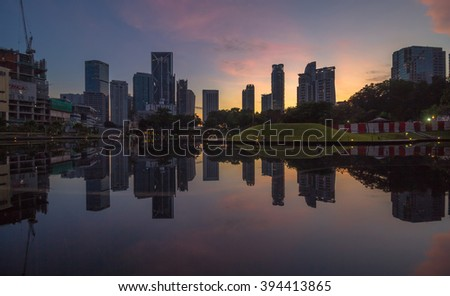 KUALA LUMPUR,MALAYSIA-DECEMBER 11 2015:Commercial buildings views from the Symphony Lake KLCC during sunrise. The image is intentionally darken to express the warm mood