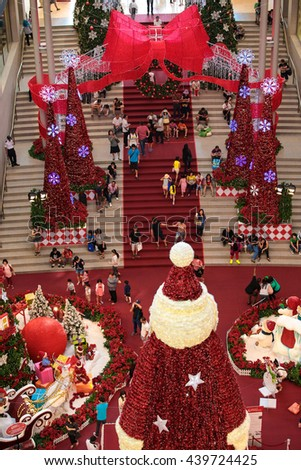 KUALA LUMPUR, MALAYSIA - DECEMBER 25, 2014 : Families and friends visiting and taking photos of the christmas decorations at Pavillion shopping complex during christmas season. - stock photo