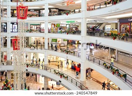 KUALA LUMPUR, MALAYSIA - DECEMBER 20 : Interior view of Suria KLCC on December 20, 2014 in Kuala Lumpur, Malaysia. Suria KLCC is the ultimate luxury shopping destination in Malaysia. - stock photo