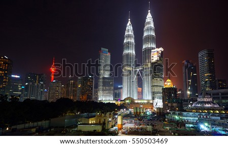 KUALA LUMPUR, MALAYSIA - DECEMBER 24: Petronas Twin Towers at night on December 24, 2015 in Kuala Lumpur. Petronas Twin Towers were the tallest buildings (452 m) in the world from 1998 to 2004.