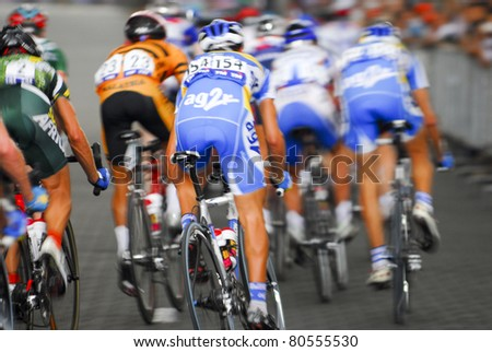KUALA LUMPUR, MALAYSIA-FEB 12: An unidentified group of cyclists in action at the final stage of  le Tour de Langkawi on February 12, 2006 in Kuala Lumpur. 119 cyclists took part in this yearly event. - stock photo
