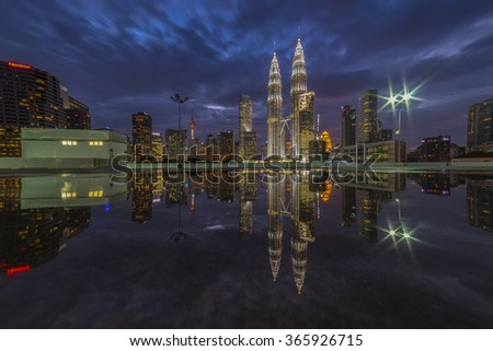 KUALA LUMPUR, MALAYSIA - FEB 20, 2016: Mirror of Petronas Twin Towers at KLCC City Center at dusk. The most popular tourist destination in Malaysian capital.