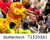 KUALA LUMPUR, MALAYSIA - FEB 7: Spectators touching the lion for blessing at Tian Hou temple during Chinese New Year on Feb. 7. 2011 in Kuala Lumpur, Malaysia. - stock photo