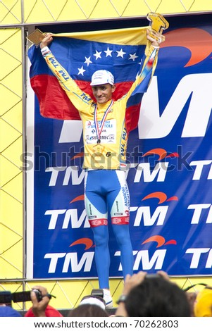 KUALA LUMPUR, MALAYSIA - FEB 1: Venezuela's Jonathan Monsalve poses with his trophies after winning the overall title of Le Tour de Langkawi cycling race on February 1, 2011 in Kuala Lumpur Malaysia